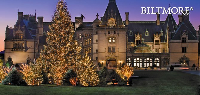 Biltmore House greets you with the soft glow of luminaries and holiday lights on a.